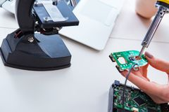 The engineer fixing broken computer hard drive Royalty Free Stock Photography
