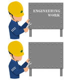 An engineer is fixing the metal sign Royalty Free Stock Images