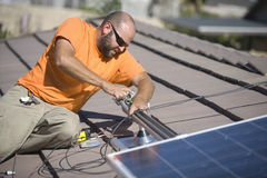 Engineer Fixing Solar Panel On Rooftop Stock Photography