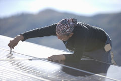 Engineer Fixing Solar Panel On Rooftop Stock Images