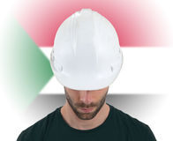 Engineer with flag on background - Sudan Royalty Free Stock Photos