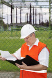 Engineer with folder near the electricity substation Stock Photography