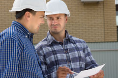 Engineer and Foreman at the Construction Site Stock Photo