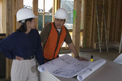 Engineer And Foreman In Discussion At Site Royalty Free Stock Photo