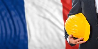 Engineer on a France flag background. 3d illustration. Engineer on a waiving France flag background. 3d illustration Royalty Free Stock Photo