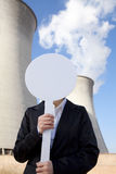 Engineer in front of cooling towers with sign Stock Photos