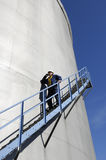 Engineer and fuel tank storage Stock Photos
