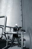 Engineer and fuel tank storage and pipeline Stock Photos