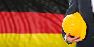 Engineer on a Germany flag background. 3d illustration. Engineer on a waiving Germany flag background. 3d illustration Royalty Free Stock Photo