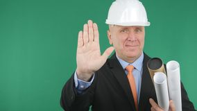 Engineer Gestures Smile and Make a Stop Hand Sign royalty free stock photo