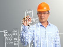 Engineer hand draw construction site on the virtual Stock Photo