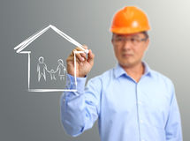Engineer hand draw a house. On the virtual screen stock image