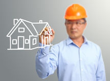 Engineer hand draw a house on the virtual Royalty Free Stock Photo