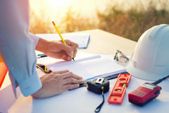 Engineer hand sketching a construction project with Pencil royalty free stock photos