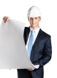 Engineer in hard hat hands blueprint. Isolated on white. Concept of successful construction Royalty Free Stock Photography