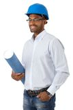 Engineer in hardhat. Portrait of smiling ethnic engineer in hardhat holding floor plan, cutout on white Stock Photography