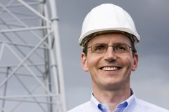 Engineer with hardhat. Smiling engineer with hardhat on construction site Royalty Free Stock Images