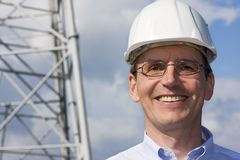 Engineer with hardhat. Smiling engineer with hardhat on construction site Stock Photos