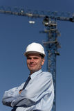 Engineer in hardhat against crane Royalty Free Stock Image