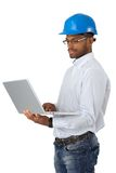 Engineer in hardhat with computer Royalty Free Stock Photography