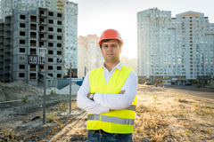Engineer in hardhat posing against building under construction Royalty Free Stock Images