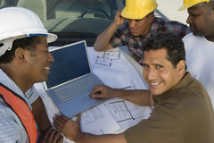 Engineer Having Discussion With Team Of Architects Royalty Free Stock Photos