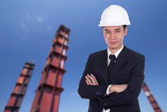 Engineer in helmet with arms crossed, construction pillar backgr Royalty Free Stock Photography