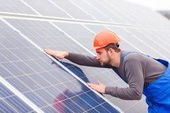 Engineer checks the solar battery royalty free stock photos