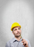 Engineer with a helmet on his head Royalty Free Stock Photos