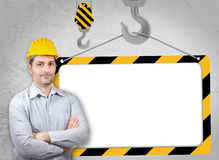 Engineer with a helmet on his head Royalty Free Stock Images