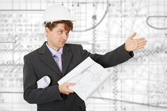 Engineer in a helmet pointing direction Stock Photo