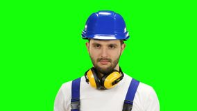 Engineer shows the cross crosswise, says no to his workers. Green screen. Engineer in the helmet shows the cross crosswise, says no to his workers, they do not stock video
