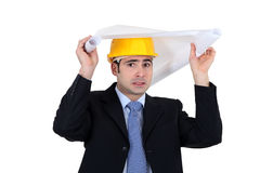 Engineer hiding under a drawing Stock Images