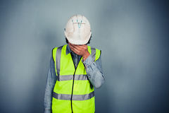 Engineer in high vis covering face Royalty Free Stock Photo