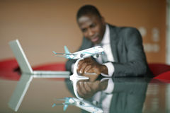 Engineer with his airplane model Stock Photos