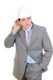 Engineer hold hand near his ear Stock Photos