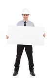 Engineer holding blank placard Royalty Free Stock Photography