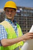 Engineer holding blueprint Royalty Free Stock Photography