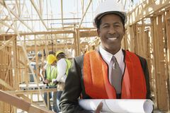 Engineer Holding Blueprint At Construction Site Stock Images