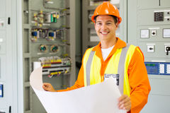 Engineer holding blueprint. Portrait of young control room engineer holding blueprint Stock Photography