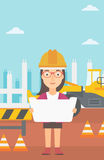 Engineer holding a blueprint. Royalty Free Stock Image