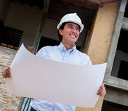 Engineer holding blueprints Royalty Free Stock Images