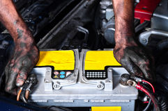 Engineer holding a car battery Royalty Free Stock Photos