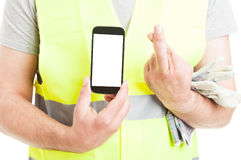 Engineer holding cellphone and fingers crossed in closeup Stock Images