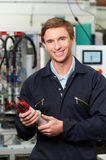 Engineer Holding Component In Factory Royalty Free Stock Photos