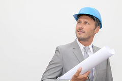 Engineer holding construction plan Stock Images
