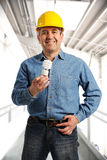 Engineer holding an electrical bulb Stock Image