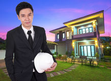 Engineer holding helmet with house background Royalty Free Stock Images