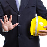 Engineer holding helmet on white background. Engineer holding a yellow helmet on white background Stock Photography