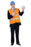 Engineer holding house of money Stock Images
